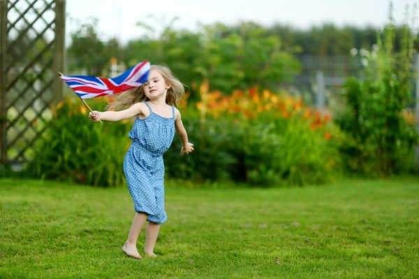 Adorable little girl with United Kingdom flag