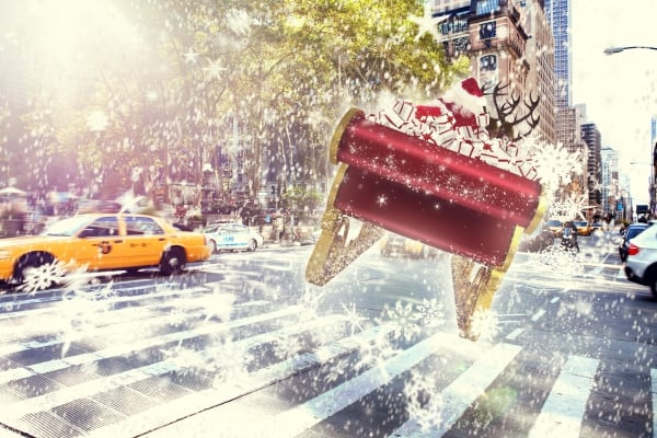 Santa flying his sleigh against new york street