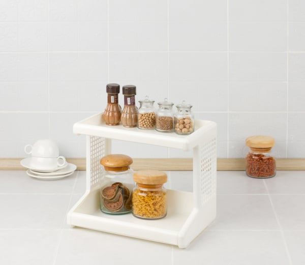 Plastic shelf with seasonings bottles