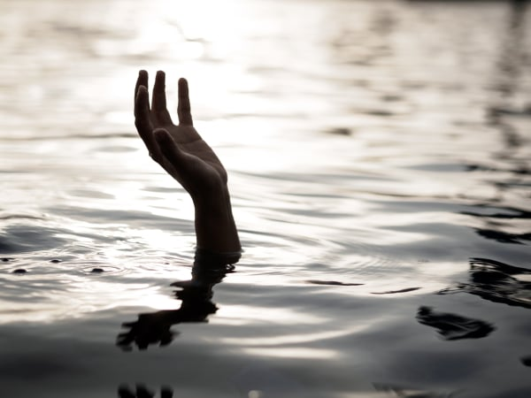 Drowning victims, Hand of drowning man needing help. Failure and