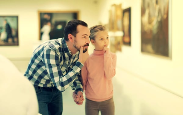 Father and daughter looking at expositions