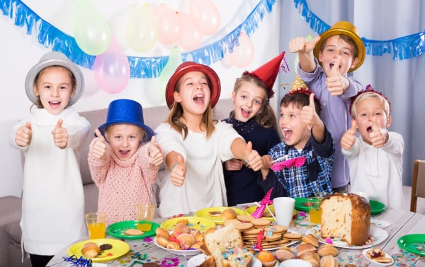 Joyous group of children happy to celebrate friend's birthday