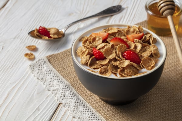 Breakfast of oatmeal with strawberries.