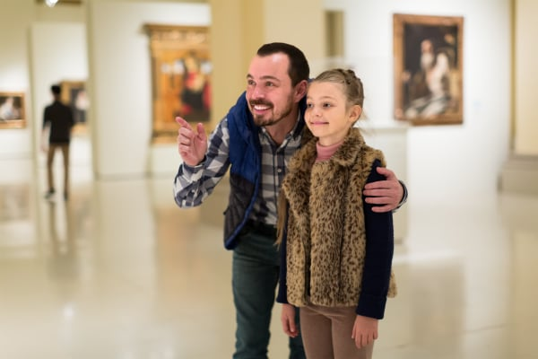father and daughter exploring expositions in museum