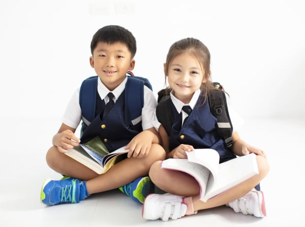 happy little boy and girl student studying