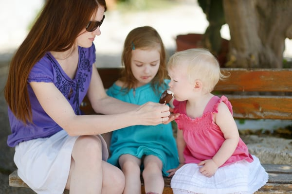Young mother and her daugthters eating ice cream