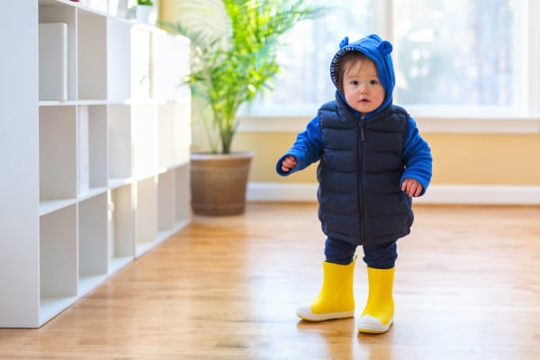 Toddler boy bundled up in winter clothes