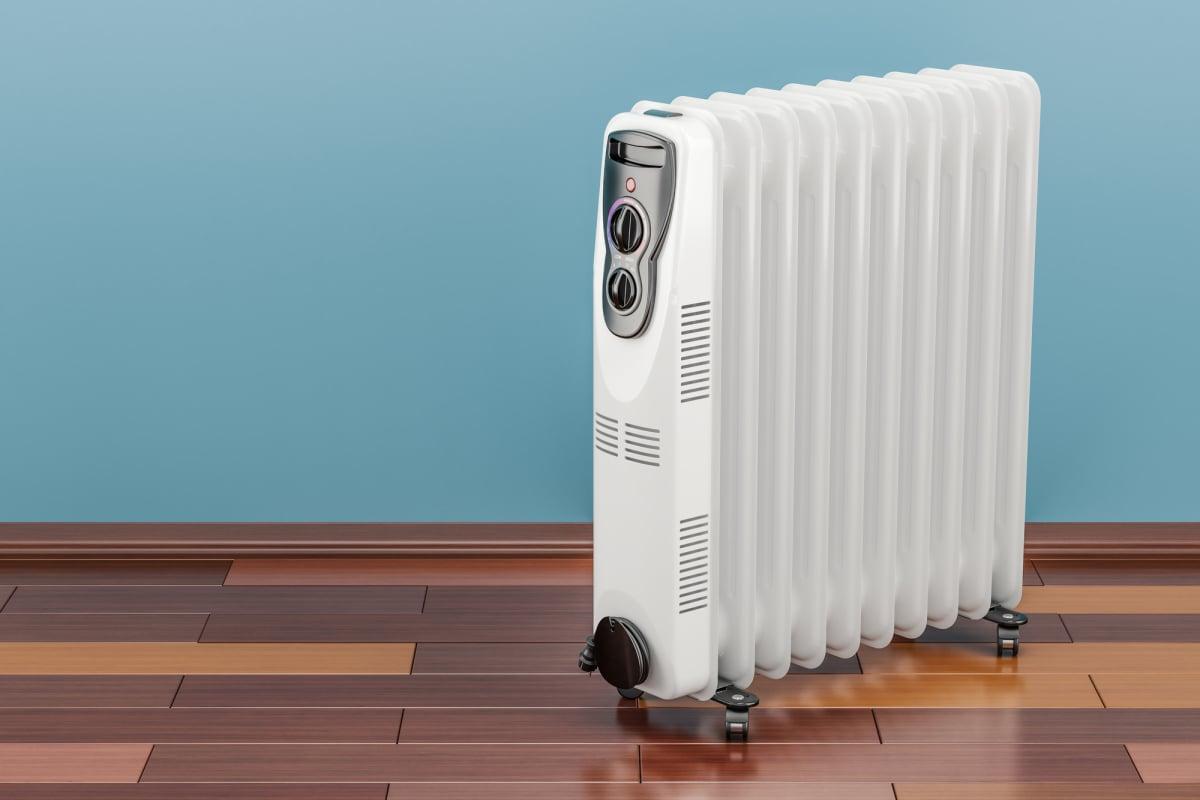 Electric oil heater, oil-filled radiator on the floor. 3D render