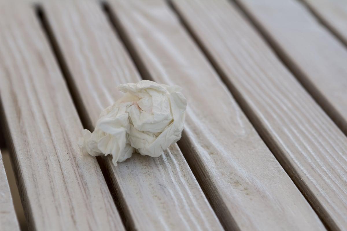 white napkin debris on a wooden table
