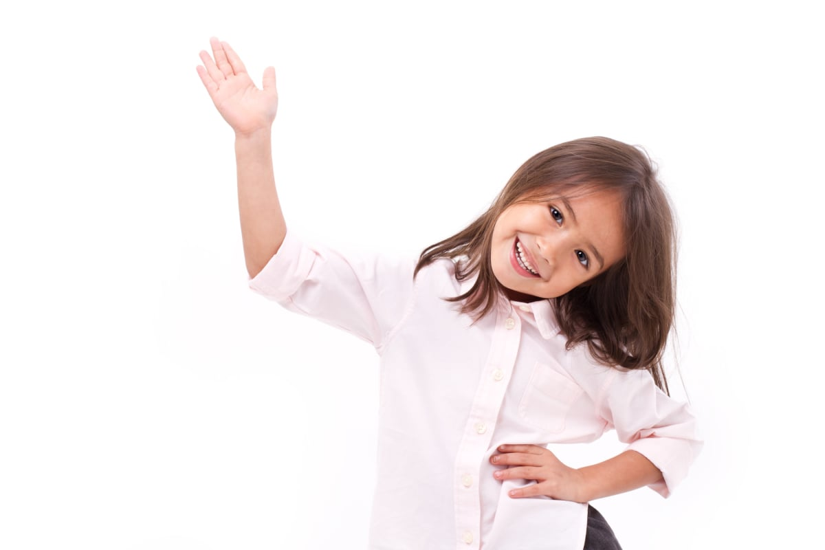 young little girl waiving her hand to you