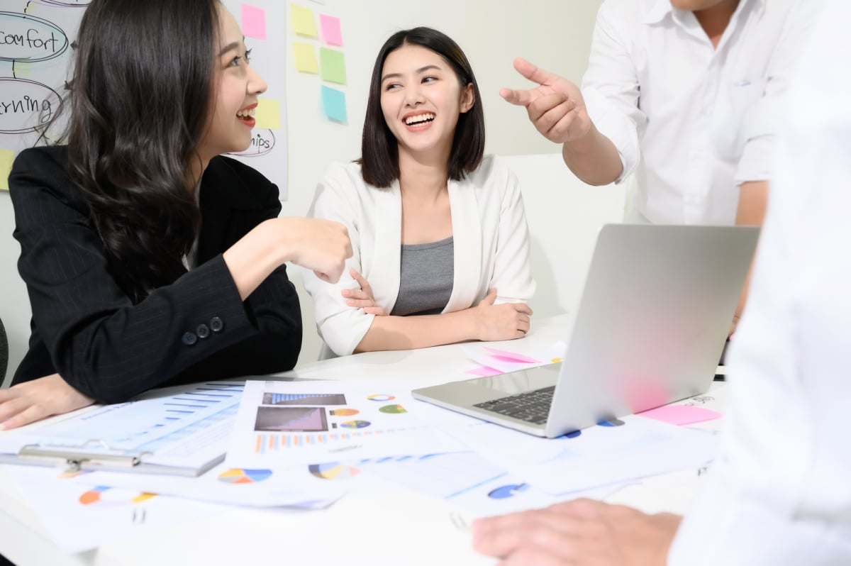 Group young asian businesswoman and businessman people have fun and talking or discuss about work in workplace