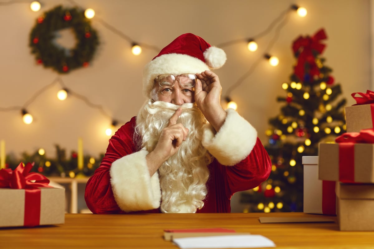Santa Claus saying Shush asking you to keep silent as he's going to tell you a wonderful secret