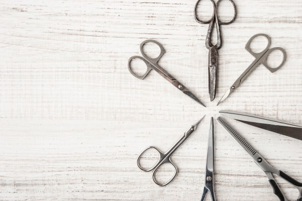 Set of scissors on a wooden table