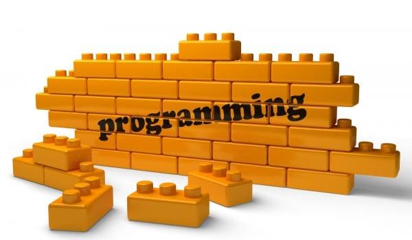 programming word on yellow brick wall